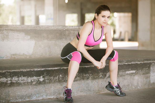 Model wearing black and pink Victoria Sport attire