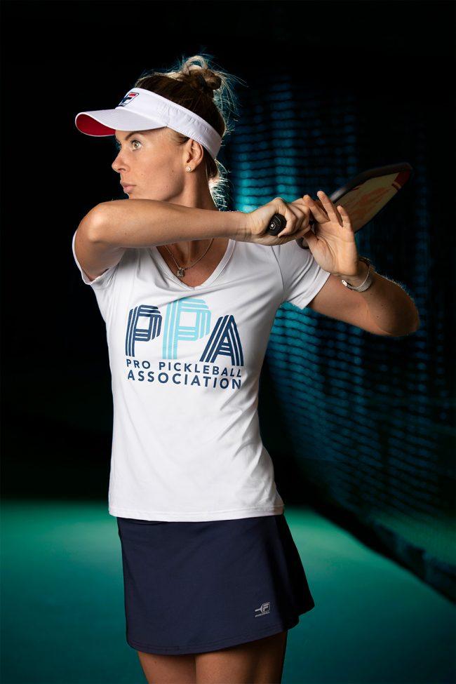 Lucy Kovalova in PPA shirt with FILA visor and skirt