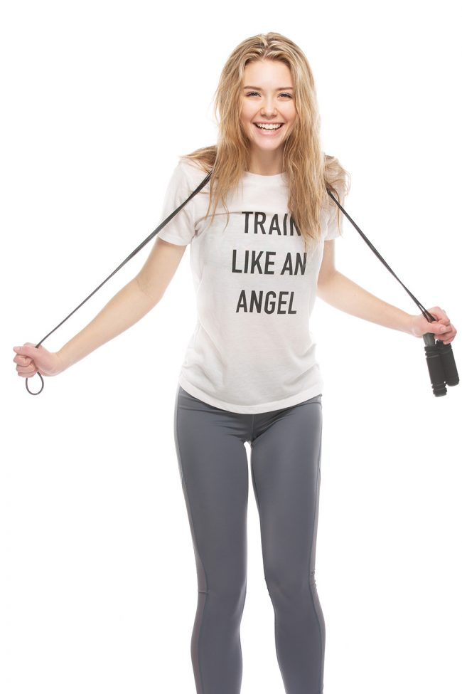 Model holding jump rope and wearing Train Like and Angel t-shirt